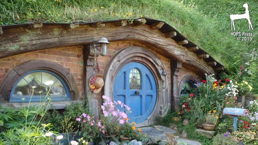 Nice Hobbit House With Timberframe And Brick Walls.