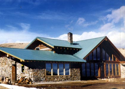 Stone and log home construction building a passive solar for Log cabin sunroom additions