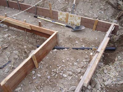 Footings foundations and monolithic concrete slabs for Pouring your own concrete driveway