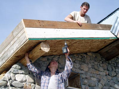Building a roof with scrap lumber.