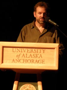 Tom Elpel speaking at a podium